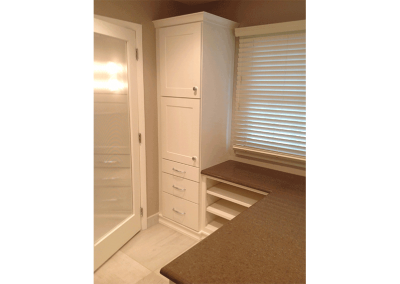 We love the frosted glass door leading into this closet.